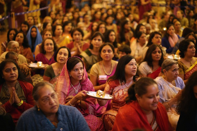 Scented candles are held by wellwishers during a ceremony as Sadhus and Hindus celebrate Diwali at the BAPS Shri Swaminarayan Mandir in London, England. Diwali, which marks the start of the Hindu New Year, is being celebrated by thousands of Hindu men women and children in the Neasden mandir, which was the first traditional Hindu temple to open in Europe. (Dan Kitwood/Getty Images)