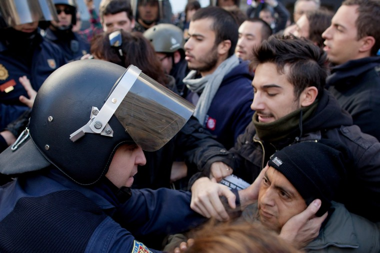 A riot policeman grabs a protester during a demonstration at Cibeles Square in Madrid, Spain. A coordinated general strike by unions in Spain and Portugal has paralyzed public transport in the two countries with further strikes planned across Europe. The strike against the governments' austerity measures have force hundreds of flights to be cancelled and factories and ports to come to a standstill. (Pablo Blazquez Dominguez/Getty Images)