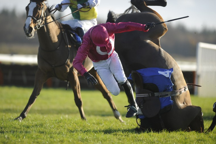Ruby Walsh riding Keppols Hill fall at the last in The Racing Welfare Jonny Brown Novice' Steeple Chase at Exeter racecourse on in Exeter, England. (Alan Crowhurst/Getty Images)