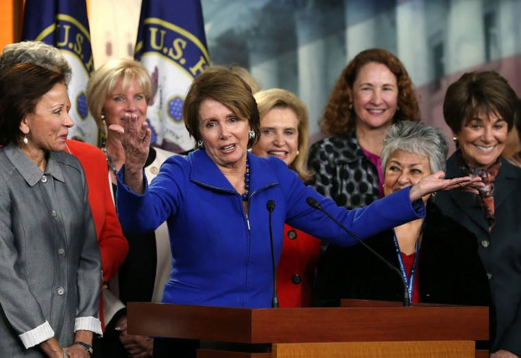 House Minority Leader Rep. Nancy Pelosi (D-CA) speaks to the media as female House Democrats gather around during a news conference at the U.S. Capitol in Washington, DC. Leader Pelosi said that she has decided continue to lead the House Democrats and does not wish to retire at this time. (Mark Wilson/Getty Images)