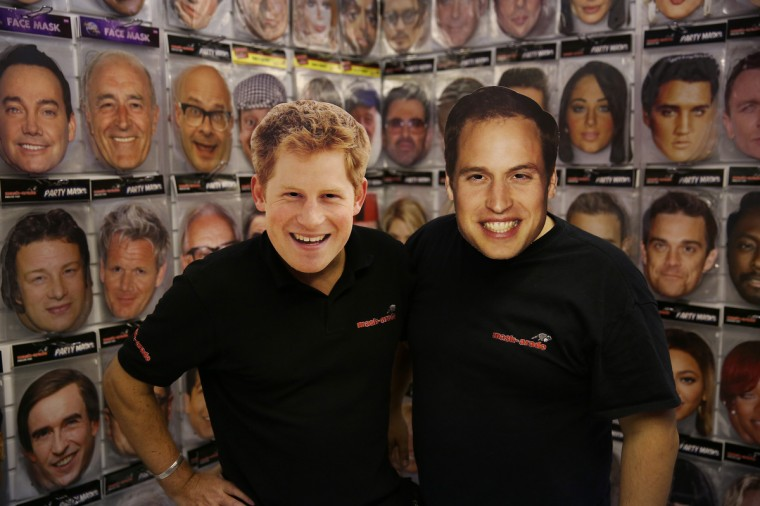 Salesman wear Prince Harry and Prince William masks at The Ideal Home Christmas Show in London, England. Over 400 exhibitors are showcasing a range of gift ideas for Christmas at the Earls Court exhibition centre. (Peter Macdiarmid/Getty Images)