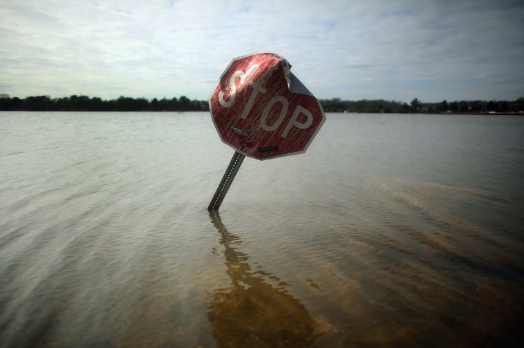 Flood waters surround a stop sign in Bay Head, New Jersey. Many residents of the hard hit seaside town remain without power following Superstorm Sandy. (Mario Tama/Getty Images)