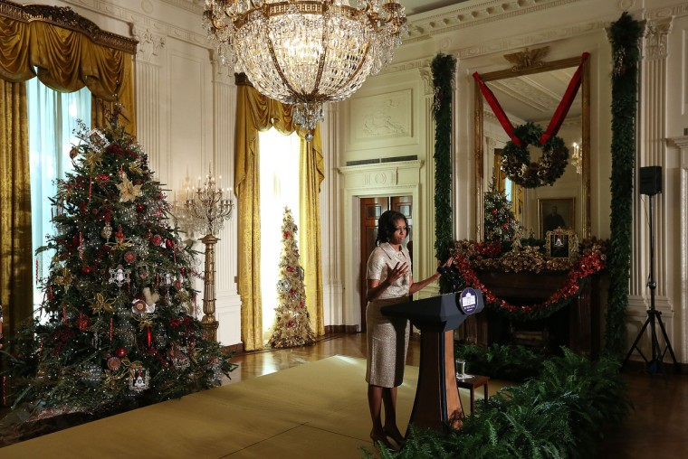 U.S. first lady Michelle Obama speaks in the East Room during a preview of the 2012 White House holiday decorations November 28, 2012 at the White House in Washington, DC. The first lady welcomed military families, including Gold Star and Blue Star parents, spouses and children, to the White House for the first viewing of the 2012 holiday decorations. (Alex Wong/Getty Images)