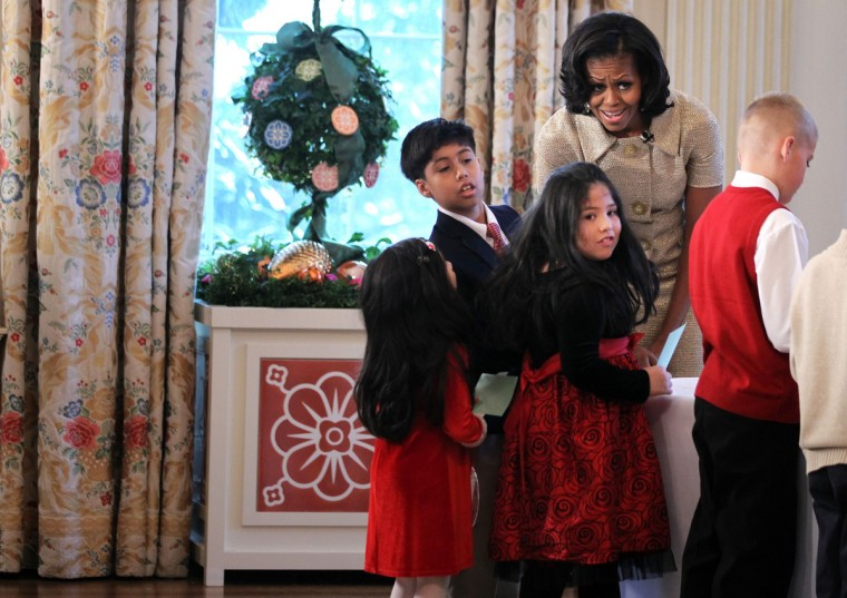 U.S. first lady Michelle Obama participates in craft activities with military children at the State Dining Room after a preview of the 2012 White House holiday decorations. (Alex Wong/Getty Images)