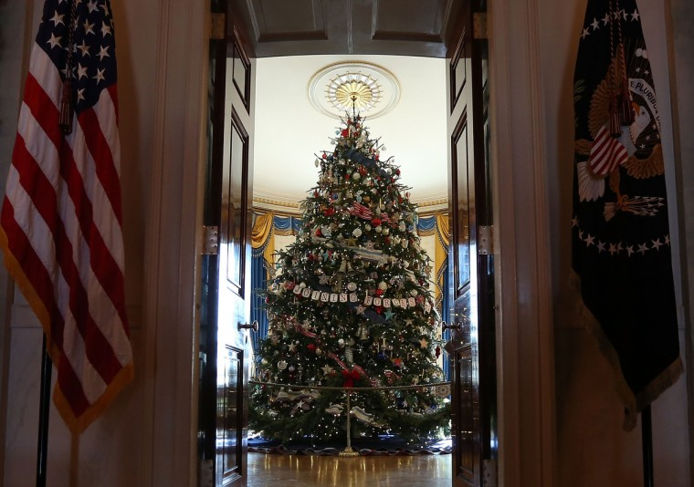 The official White House Christmas tree, an 18-foot-6-inch Fraser Fir from Jefferson, North Carolina, stands in the Blue Room during a preview of the 2012 White House holiday decorations November 28, 2012 at the White House in Washington, DC. (Alex Wong/Getty Images)
