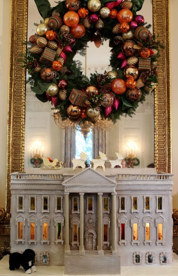 A nearly 300-pound White House gingerbread house is on display at the State Dining Room during a preview of the 2012 White House holiday decorations at the White House in Washington, DC. (Alex Wong/Getty Images)