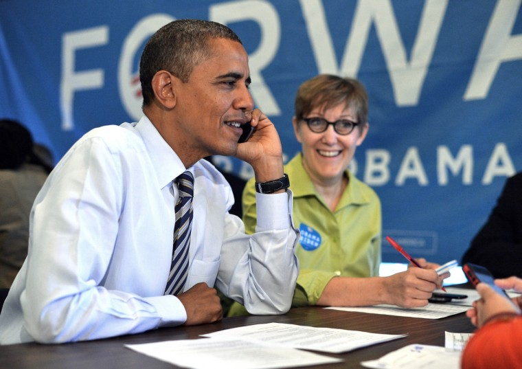US President Barack Obama calls a volunteer from a campaign office in Chicago, Illinois, on election day, November 6, 2012. US polling stations opened on November 6, with Democratic incumbent Barack Obama and Republican challenger Mitt Romney locked in a tight presidential contest after a burst of last-minute campaigning. (Jewel Samad/Getty Images)