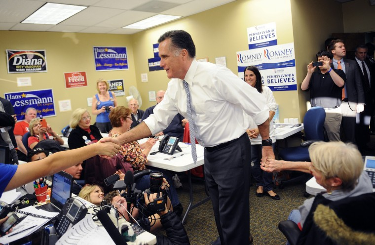 US Republican presidential candidate Mitt Romney greets volunteers, as he pays a visit to a campaign call center in Green Tree, Pennsylvania, November 6, 2012. (Emmanuel Dunande/Getty Images)