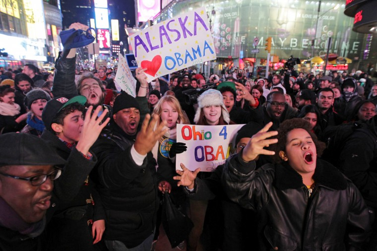 People celebrate in Times Square as US networks projected that President Obama has been re-elected during the 2012 Presidential Election in New York, New York on November 6, 2012. (Mehdi Taamallah/Getty Images)