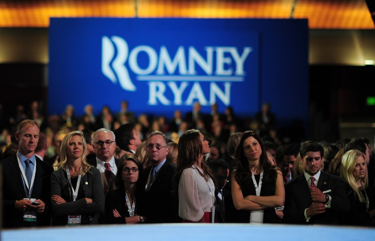Supporters of US Republican presidential candidate Mitt Romney react on election night on November 7, 2012 in Boston. President Barack Obama swept to re-election, forging history again by transcending a slow economic recovery and the high unemployment which haunted his first term to beat Republican Mitt Romney. (Emmanuel Dunand/Getty Images)