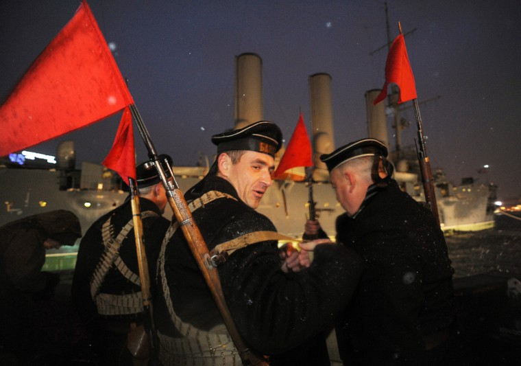 Russian Communist party supporters wearing naval uniforms of the beginning of the last century attend a rally in central St. Petersburg on November 7, 2012, marking the 95th anniversary of the October 1917 Bolshevik Revolution. (Olga Maltseva/AFP/Getty)