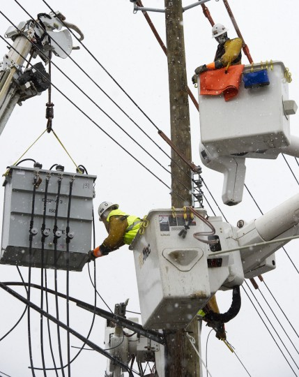 Linemen from Chain Electric, a contract utility crew that drove in from Mississippi to help Consolidated Edison , install a new transformer November 7, 2012, to help restore electric power that has been out since Hurricane Sandy struck the East Coast, in the community of Oakwood Beach, on Staten Island, New York. (Paul J. Richards/Getty Images)