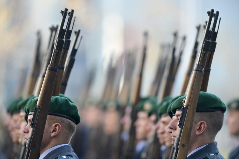 German soldiers wait for the welcoming ceremony with guard of honor at the Chancellery in Berlin. German Chancellor Angela Merkel hosts Polish Prime Minister Donald Tusk for talks expected to focus on the forthcoming EU summit on the bloc's seven-year budget. (Odd Andersen/Getty Images)