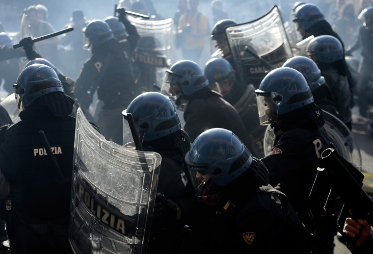 Rio policemen fight with demonstrators during a protest on a day of mobilization against austerity measures by workers in southern Europe in Rome. Riot police and anti-austerity protesters clashed in Italy on Wednesday as anger boiled over on a Europe-wide day of strikes and mass demonstrations. (Filippo Monteforte/Getty Images)
