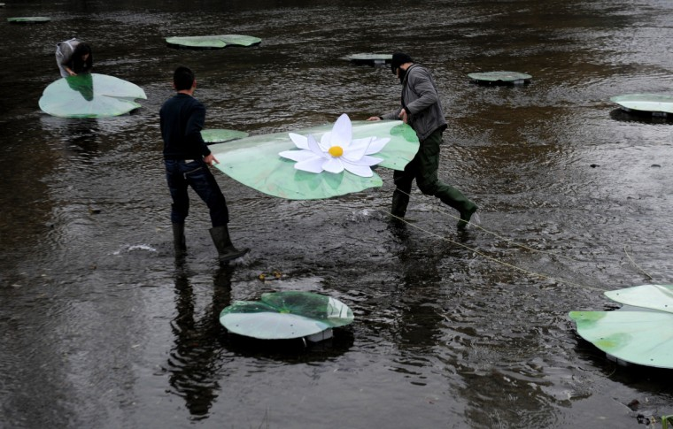 Kosovo Albanian artists set up a bridge made of water lilies across the Ibar river in the ethnically divided flashpoint town of Mitrovica in protest at the real bridge being blocked. The actual bridge linking the Albanian-populated south with the Serb-populated north of Mitrovica is closed off by a huge cement barricade, preventing any interaction between the two sides. Mitrovica in particular often the scene of violent clashes as local Serbs refuses to recognize the ethnic Albanian government in Pristina. (Armend Nimani/Getty Images)