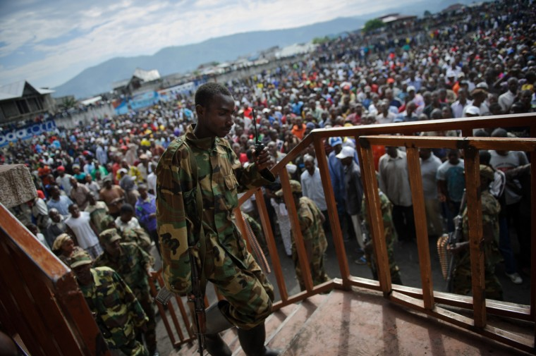 An M23 rebel soldier climbs some steps in the Volcanoes Stadium in Goma. The spokesman of the M23 rebel group Vianney Kazarama addressed the population of Goma today in an attempt to calm and reassure the civilians following the fall of Goma to M23 rebels yesterday. (Phil Moore/GettyImages)