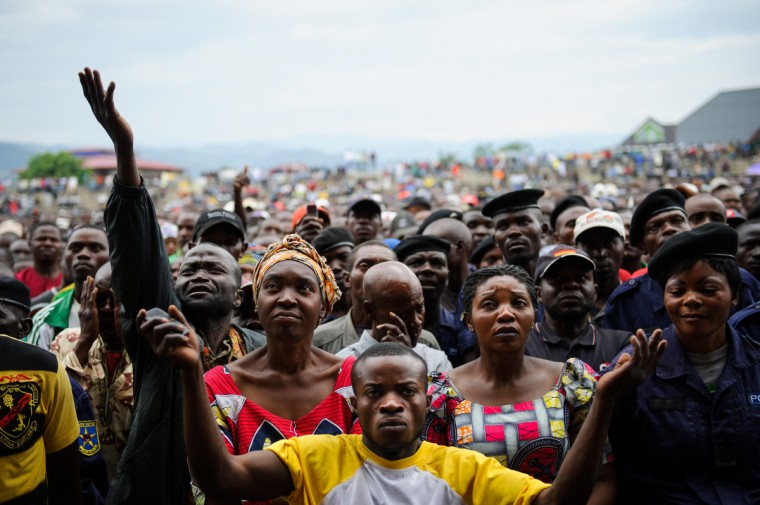 Residents of Goma react as they listen to M23 rebel group spokesman at the Volcanoes Stadium in Goma, in the east of the Democratic Republic of the Congo. Lt.-Col. Kazarama addressed the population of Goma today in an attempt to calm and reassure the civilians following the fall of Goma to M23 rebels yesterday. (Phil Moore/GettyImages)