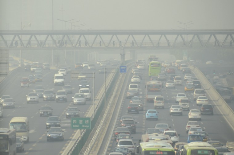 "Traffic commutes through heavy smog in Beijing. China will start assessing the ""social risk"" of major projects, its environmental protection minister said, after anti-pollution protests forced a series of industrial ventures to be cancelled. (Wang Zhao/Getty Images)"