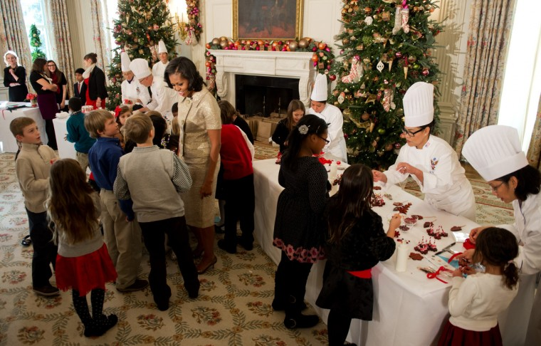 First Lady Michelle Obama (C) talks with young children during the first viewing of the White House 2012 holiday decorations in Washington, DC. (Jim Watson/Getty Images)