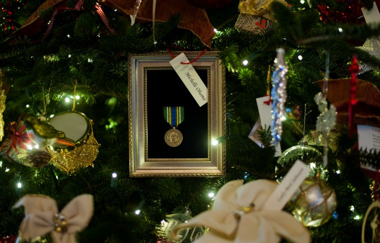 First Lady Michelle Obama's ornament from 2011 adorns a first lady Chirstmas tree in the Grand Foyer that holds White House ornaments from Christmases past during the first viewing of the White House 2012 holiday decorations in Washington, DC. (Jim Watson/Getty Images)