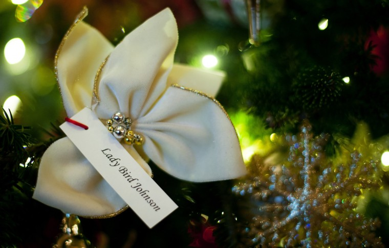 Former First Lady Lady Bird Johnson's ornament adorns a first lady Christmas tree in the Grand Foyer that holds White House ornaments from Christmases past during the first viewing of the White House 2012 holiday decorations in Washington, DC. (Jim Watson/Getty Images)