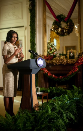 First Lady Michelle Obama deliver remarks during the first viewing of the White House 2012 holiday decorations in Washington, DC. (Jim Watson/Getty Images)
