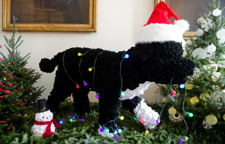 A Christmas decoration of the presidential dog Bo stands during the first viewing of the White House 2012 holiday decorations in Washington, DC. (Jim Watson/Getty Images)