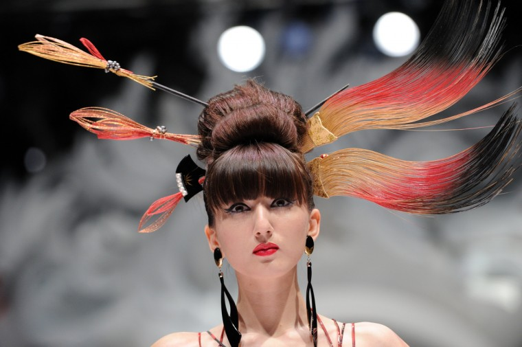 A model presents a creation by Japanese designer Yumi Katsura during the Japan Couture 2012 Women Fashion Week in Singapore. (Roslan Rahman/Getty Images)