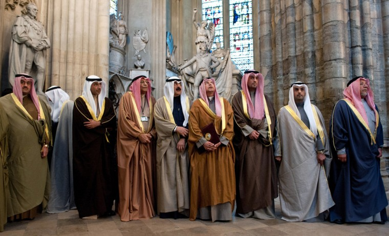 Members of the delegation accompanying the Emir of Kuwait, Sheikh Sabah al-Ahmad al-Jaber al-Sabah (unseen), look around Westminster Abbey during a visit in London. The Emir of Kuwait is on day three of his state visit which is the first from Kuwait to Britain since 1995. (Will Oliver/Getty Images)