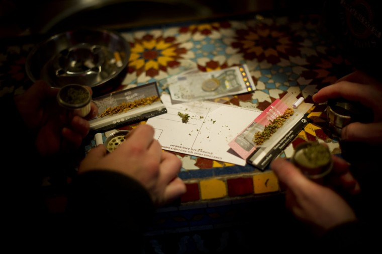 November 1, 2012: Cannabis joints are being rolled, costing 10 Euros per gram, in a coffee shop in the center of Amsterdam, Netherlands. (Jasper Juinen/Getty Images)