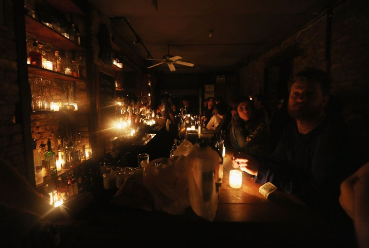 People gather in Bua bar, lit only by candles, in Manhattan'€™s East Village following Superstorm Sandy on November 1, 2012 in New York City. East Village residents are still without power and some of the public housing buildings in the area flooded during the storm. (Mario Tama/Getty Images)