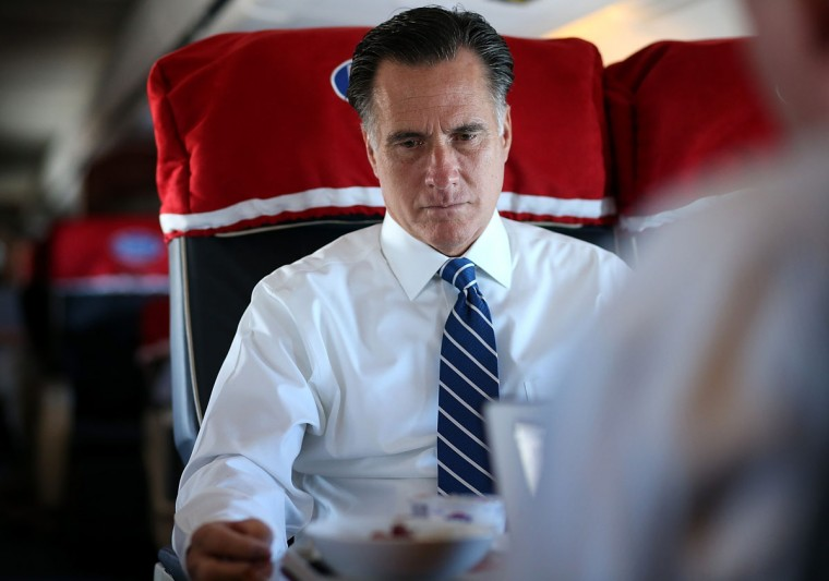Republican presidential candidate Mitt Romney sits aboard his campaign plane on November 2, 2012, en route to Milwaukee, Wisconsin. With less than one week to go before election day, Mitt Romney is campaigning in Wisconsin and Ohio. (Justin Sullivan/Getty Images)