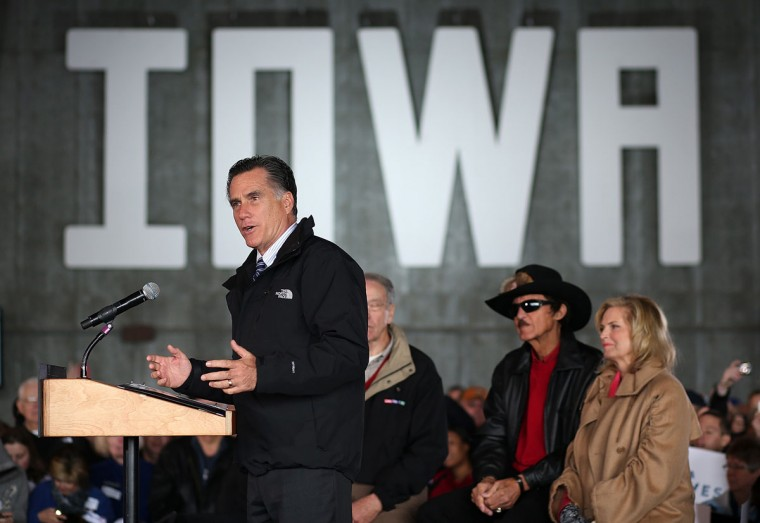 Republican presidential candidate Mitt Romney speaks during a campaign rally at Dubuque Jet Center as his wife Ann Romney and former NASCAR driver Richard Petty listen in Dubuque, Iowa. With less than a week before election day, Romney is actively campaigning in battleground states across the country. (Justin Sullivan/Getty Images)
