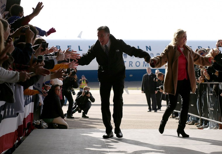 Republican presidential candidate Mitt Romney and his wife Ann Romney greet supporters during a campaign rally at Dubuque Jet Center in Dubuque, Iowa. With less than a week before election day, Romney is campaigning in battleground states across the country. (Justin Sullivan/Getty Images)