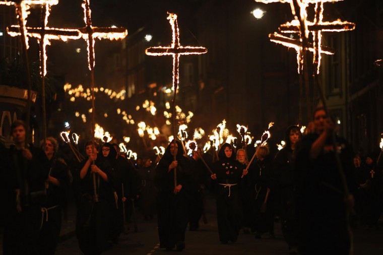 Revelers walk with burning crosses during the Bonfire Night celebrations on November 5, 2012 in Lewes, Sussex in England. Bonfire Night is related to the ancient festival of Samhain, the Celtic New Year. Processions held across the South of England culminate in Lewes on November 5, commemorating the memory of the seventeen Protestant martyrs. (Dan Kitwood/Getty Images)