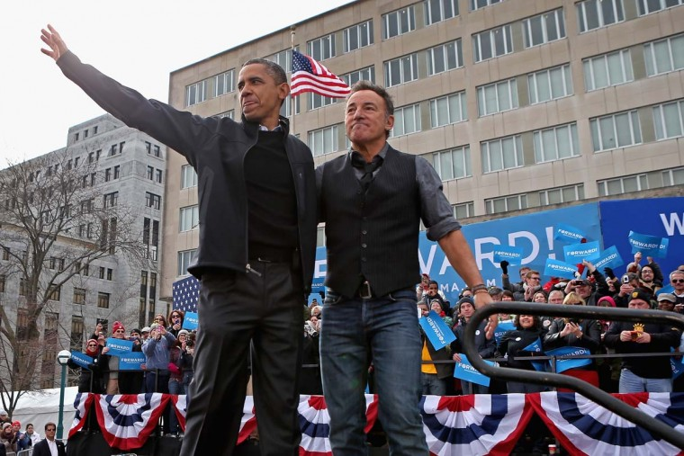 U.S. President Barack Obama and rocker Bruce Springsteen wave to a crowd of 18,000 people during a rally on the last day of campaigning in the general election November 5, 2012 in Madison, Wisconsin. (Chip Somodevilla/Getty Images)