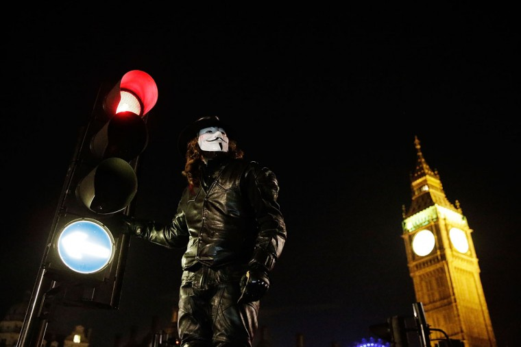 Members of the Anonymous group protest outside the Houses of Parliament on November 5, 2012 in London, England. The group wear masks inspired by a character from the film 'V for Vendetta,' which culminates in the march en masse of the public against parliament, in protest against a authoritarian goverment, on the fifth of November. (Matthew Lloyd/Getty Images)