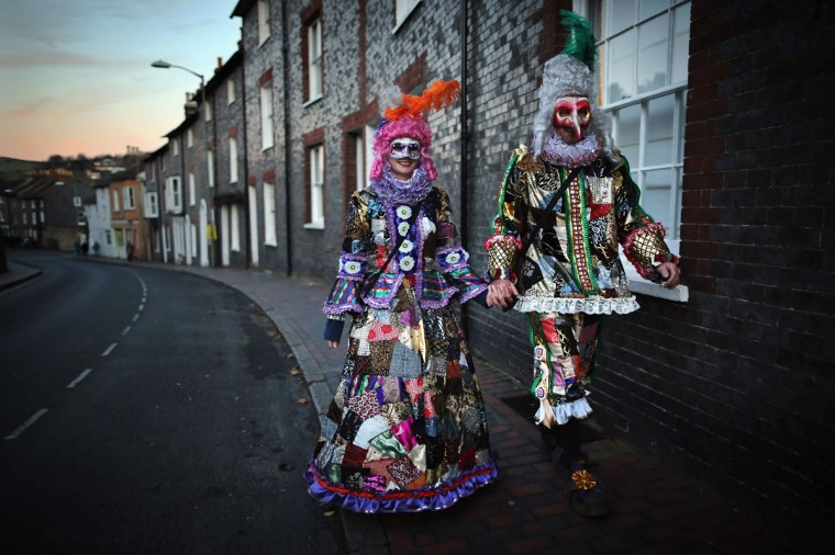 Members of the phoenix Bonfire Society walk to join a procession ahead of the Bonfire Night celebrations on November 5, 2012 in Lewes, Sussex in England. Bonfire Night is related to the ancient festival of Samhain, the Celtic New Year. (Dan Kitwood/Getty Images)