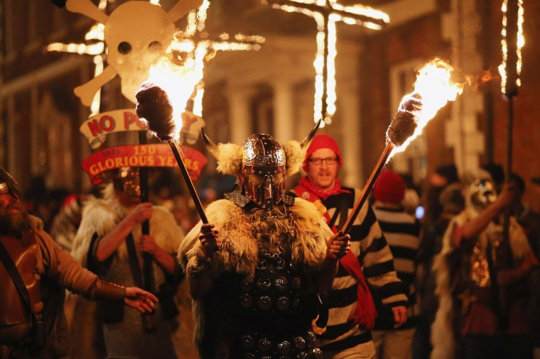 Bonfire societies parade through the streets during the Bonfire Night celebrations on November 5, 2012 in Lewes, Sussex in England. Bonfire Night is related to the ancient festival of Samhain, the Celtic New Year. Processions held across the South of England culminate in Lewes on November 5, commemorating the memory of the seventeen Protestant martyrs. (Dan Kitwood/Getty Images)