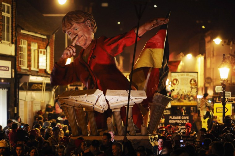 An effigy of German Chancellor Angela Merkel is paraded as bonfire societies process through the streets during the Bonfire Night celebrations on November 5, 2012 in Lewes, Sussex in England. Thousands of people attend the parade as Bonfire Societies parade through the narrow streets until the evening comes to an end with the burning of an effigy, or 'guy,' usually representing Guy Fawkes, who died in 1605 after an unsuccessful attempt to blow up The Houses of Parliament. (Dan Kitwood/Getty Images)