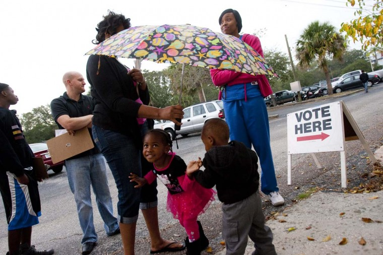 ST. PETERSBURG, FL: Voters wait to cast their ballots on November 6, 2012 in St. Petersburg, Florida. The swing state of Florida is recognized to be a hotly contested battleground that offers 29 electoral votes, as recent polls predict that the race between U.S. President Barack Obama and Republican presidential candidate Mitt Romney remains tight. (Edward Linsmier/Getty Images)