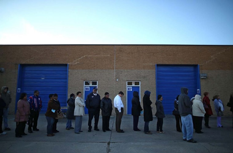 MILFORD, VA: People wait in line to vote at Caroline High School on November 6, 2012 in Milford, Virginia. The swing state of Virginia is recognized to be a hotly contested battleground that offers 13 votes, with recent polls showing that the race between U.S. President Barack Obama and Republican presidential candidate Mitt Romney remains tight. (Mark Wilson/Getty Images)