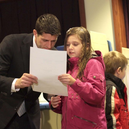 JANESVILLE, WI: Republican vice presidential candidate U.S. Rep. Paul Ryan (R-WI) show his daughter Liza Ryan (R) his ballet before he casts' his vote in the 2012 Presidential election on November 6, 2012 Janesville, Wisconsin. As Americans are heading to the ballots, polls show that U.S. President Barack Obama and Republican presidential candidate Mitt Romney are in a tight race. (Darren Hauck/Getty Images)