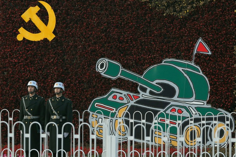 Chinese soldiers stand guard on Chang'an Avenue in Beijing, China. The18th National Congress of the Communist Party of China (CPC) is proposed to convene on November 8 in Beijing. (Feng Li/Getty Images)