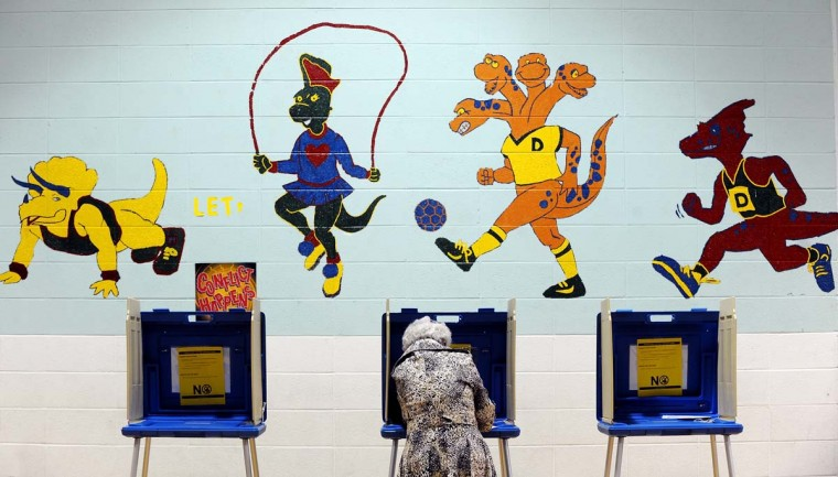 RALEIGH, NC: A voter casts her ballot in the gymnasium of Douglas Elementary School on November 6, 2012 in Raleigh, North Carolina. Early voting across North Carolina saw high numbers in early turn-out. As Americans go to vote, U.S. President Barack Obama and Republican presidential candidate Mitt Romney are in a virtual tie in the national polls. ( Sara D. Davis/Getty Images)