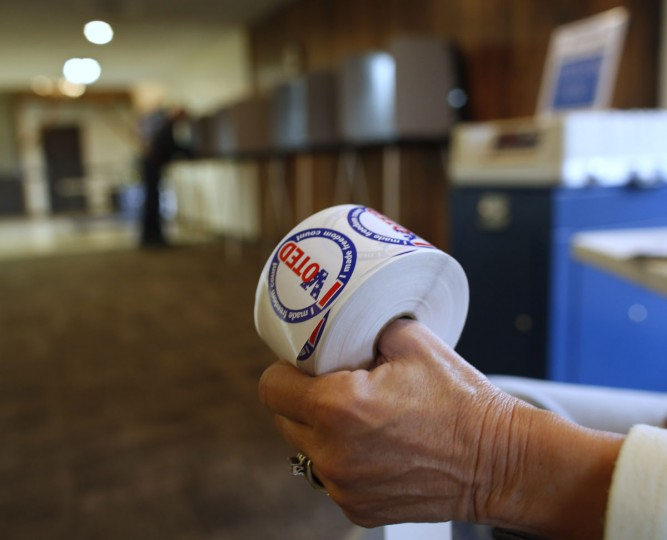 "A woman holds a roll of ""I Voted"" stickers during the U.S. presidential election on Election Day in Johnstown, Wisconsin. (Darren Hauck/Getty Images)"
