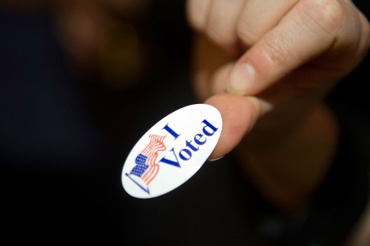 "An American expat displays an ""I Voted' sticker in London, England. (Bethany Clarke/Getty Images)"
