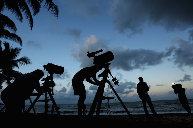 Telescopic cameras and computer equipment are set up on Palm Cove beach in preparation to run a live stream via NASA of the total solar eclipse on November 13, 2012 in Cairns, Australia. (Mark Kolbe/Getty Images)