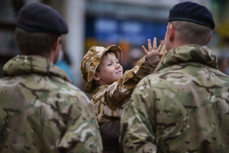 Kyle McClements, 4 years old from Dundee, joins soldiers from 19th Regiment Royal Artillery the Highland Gunners as they take part in a Homecoming Parade in Dundee, Scotland. The Regiment, who are based at Bhurtpore Barracks in Tidworth Camp in Wiltshire, are taking part in two Homecoming Parades in Dundee and Inverness to mark their recent return from operations in Afghanistan. (Jeff J Mitchell/Getty Images)