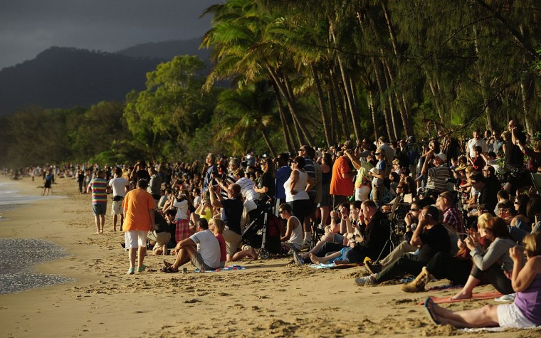 Spectators line the beach to view the total solar eclipse on November 14, 2012 in Palm Cove, Australia. (Ian Hitchcock/Getty Images)